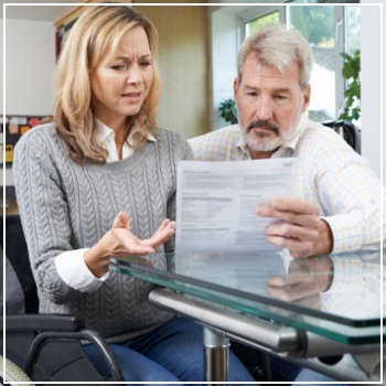 Confused couple looking at paperwork