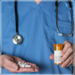 doctor holding pills and medicine bottle
