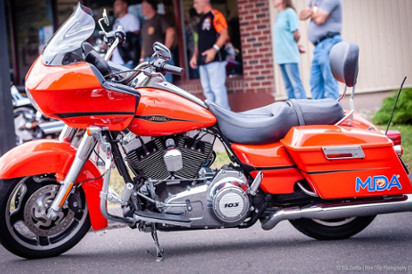 Orange motorcycle with MDA logo