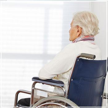 Nursing home patient in wheelchair