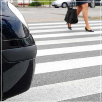 female pedestrian crossing the street