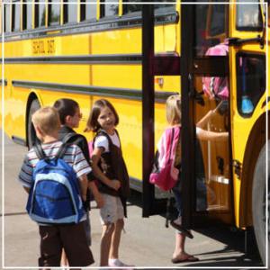 elementary school children boarding the school bus