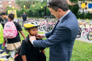 Attorney Keith Trantolo fitting a bicycle helmet