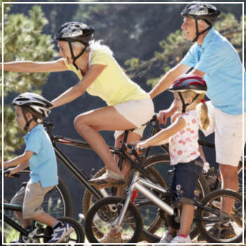 seniors biking with their grandchildren