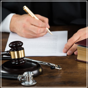 Medical malpractice lawyer signing paperwork