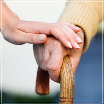 elderly hand on a cane