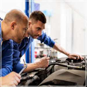 mechanics inspecting vehicle