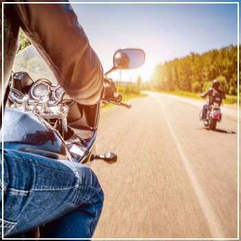 motorcyclists riding on a sunny day