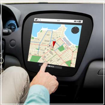 man operating touchscreen navigation in car