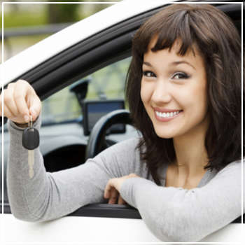 teen driver holding keys out the car window