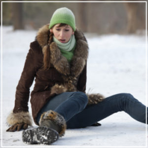 woman fallen on snow and ice