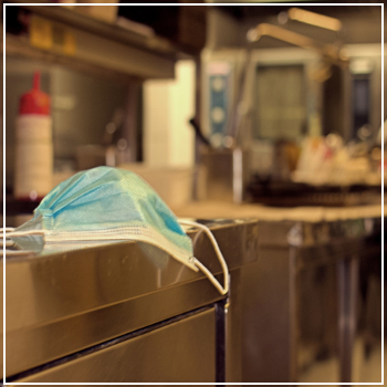 protective mask in restaurant kitchen