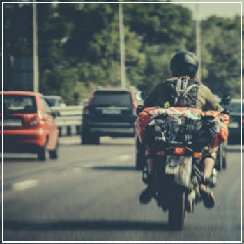 motorcycle riding with traffic