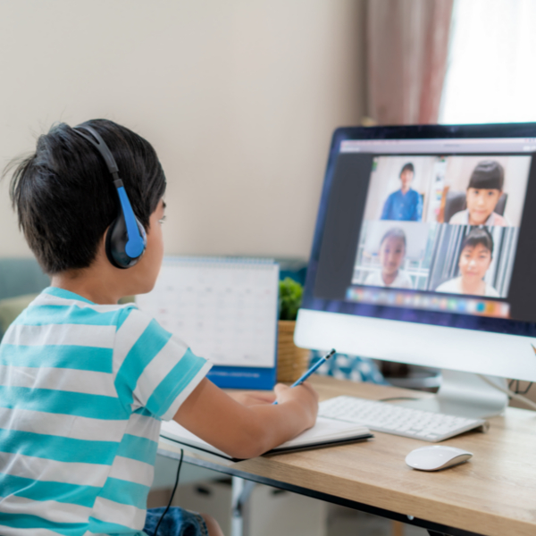 young boy learning online