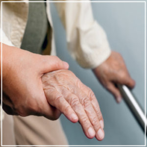 elderly hand holding railing