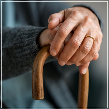 elderly hands on cane