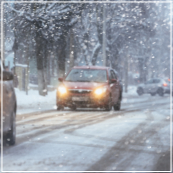 cars in a snowstorm