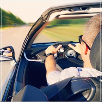 driver speeding on open road