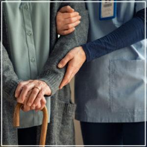 caregiver helping nursing home patient