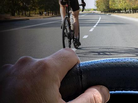 motorist following a bicycle